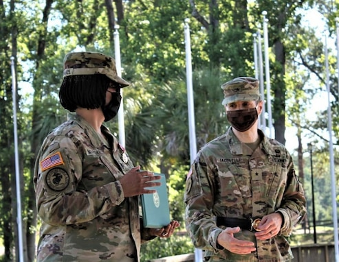 Brig. Gen. Stephen Iacovelli (right), 94th Training Division-Force Sustainment commanding general, gives remarks after presenting Col. Janene Marshall-Gatling, outgoing 4th Brigade (Personnel Services) commander with the Meritorious Service Medal for her commitment to duty and superior performance as the 4th Brigade's commander during the unit's change of command ceremony. The ceremony was held on Victory Field at Fort Jackson, S.C., July 11, 2020. Marshall-Gatling served as the 4th Brigade (PS) commander for two years before her relinquishment of command to Col. Aaron Wilkes. (U.S. Army Reserve photo courtesy of 1st Lt. Matthew Rutledge, 4th Brigade (PS), 94th TD-FS)
