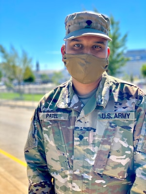 Kentucky National Guard Spc. Jayendra Patel takes a moment while working for his unit in Louisville during the Kentucky Derby, Sept. 5, 2020. While stranded in his hometown in India during the COVID-19 pandemic, he used his experience as a culinary specialist to feed hundreds of people.