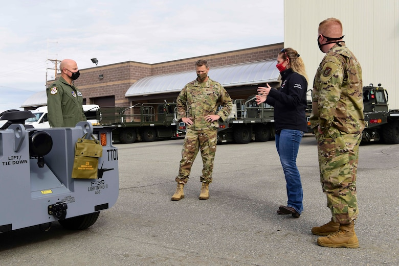 U.S. Air Force Col. David Berkland, the 354th Fighter Wing (FW) commander, and Chief Master Sgt. John Lokken, the 354th FW command chief, interact with 2nd Lt. Chance Wessel, the 354th Logistics Readiness Squadron (LRS) assistant installation deployment officer, and Holly Kinsey, the 354th LRS installation deployment officer during a wing leadership immersion at Eielson Air Force Base, Alaska, Sept. 15, 2020.