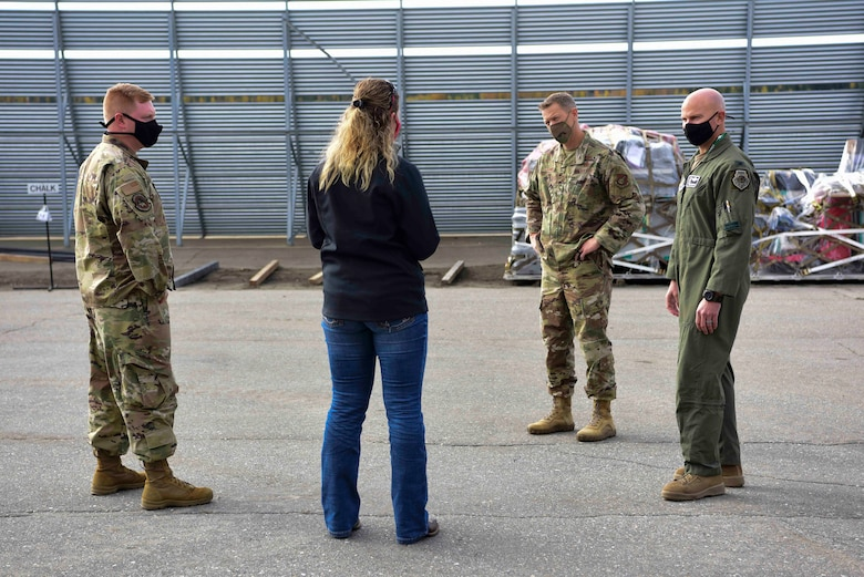 U.S. Air Force Col. David Berkland, the 354th Fighter Wing (FW) commander, and Chief Master Sgt. John Lokken, the 354th FW command chief, talk to 2nd Lt. Chance Wessel, the 354th Logistics Readiness Squadron (LRS) assistant installation deployment officer, and Holly Kinsey, the 354th LRS installation deployment officer at Eielson Air Force Base, Alaska, Sept. 15, 2020.