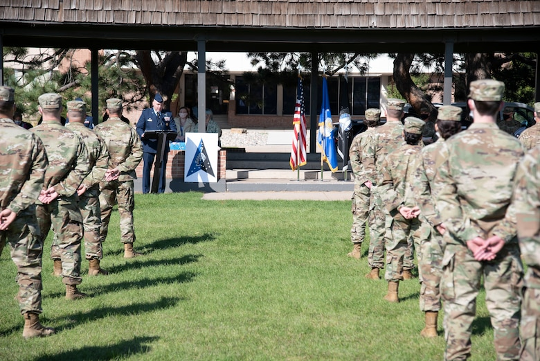 Colonel addressing Airmen in formation
