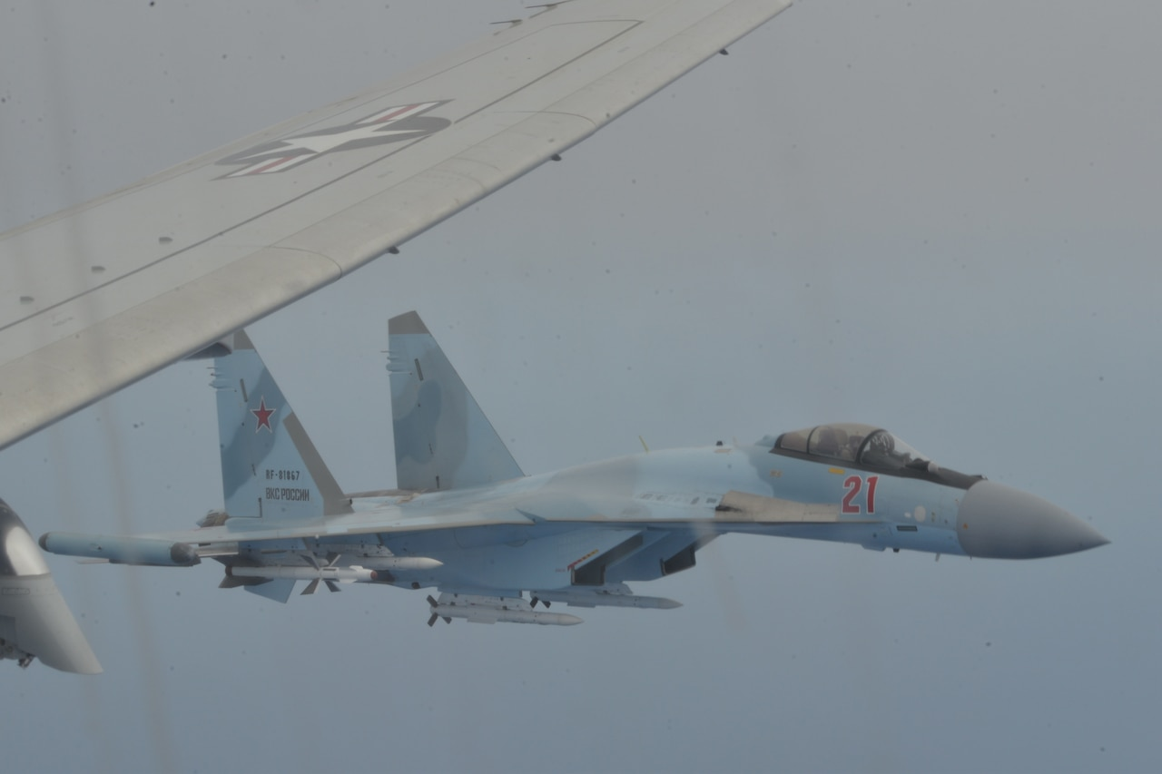 Two aircraft fly in close proximity.