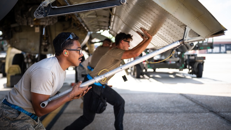 Senior Airman Timothy Pierce, 20th Aircraft Maintenance Unit weapons load crew member, lifts a B-52H Stratofortress bomb bay door at Barksdale Air Force Base, La., at Barksdale Air Force Base, La., Aug. 24, 2020. The equipment for testing is attached to the warhead and is able to record timing and voltages across the warhead, missile and the aircraft. (U.S. Air Force photo by Senior Airman Lillian Miller)