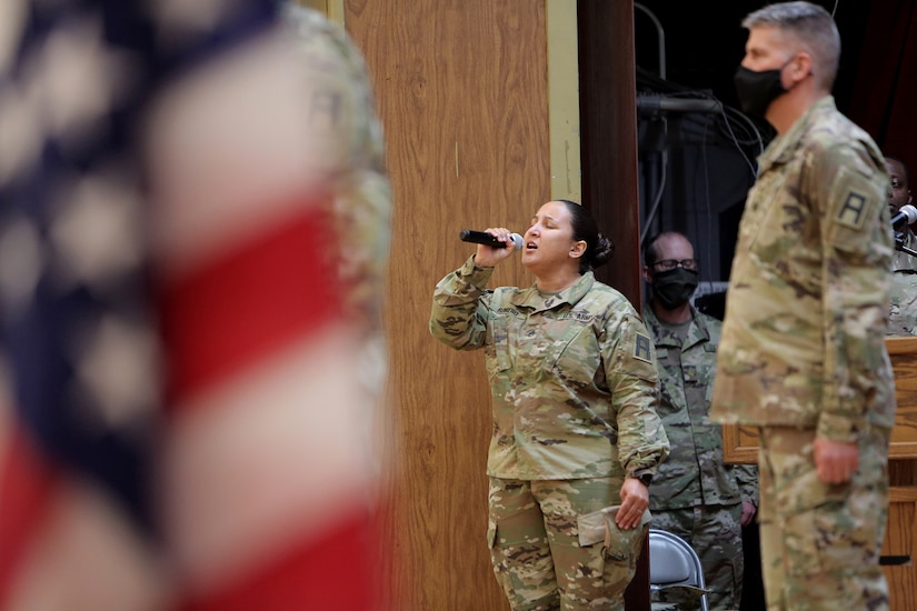 Staff Sgt. Natalie Romero, 5th Armored Brigade, sings the National Anthem during a Transfer of Authority ceremony at Fort Bliss, Texas, September 11, 2020.