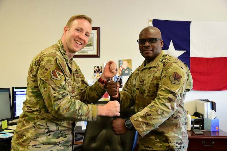 A photo of two Airmen.