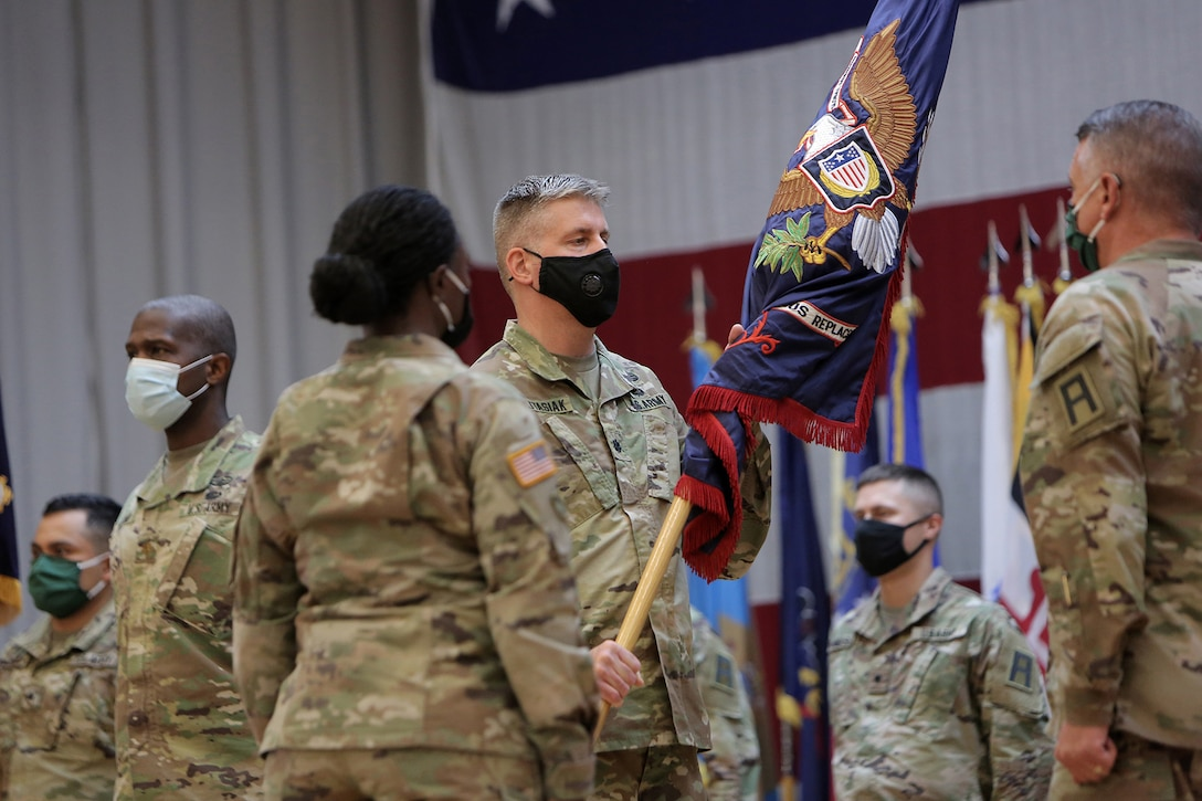 """Lt. Col. Brian Wojtasiak, Commander of """"Viper 9"""" and the CONUS Replacement Center, receives the Colors during a Transfer of Authority ceremony at Fort Bliss, Texas, September 11, 2020."""