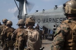 U.S. reconnaissance Marines with the Maritime Raid Force, 31st Marine Expeditionary Unit (MEU) exfiltrate towards a CH-53E Super Stallion with Marine Medium Tiltrotor Squadron 262 (Reinforced), 31st MEU, during a simulated visit, board, search, and seizure (VBSS) mission aboard dock landing ship USS Germantown (LSD 42). VBSS is a part of Maritime Interception Operations that aim to delay, disrupt, or destroy enemy forces or supplies in the maritime domain. Germantown, part of the America Amphibious Ready Group (ARG), 31st MEU team, is operating in the U.S. 7th Fleet area of operations to enhance interoperability with allies and partners and serve as a ready response force to defend peace and stability in the Indo-Pacific region. The America ARG, 31st MEU team remains the premier crisis response force in the region despite the unique challenges caused by the COVID-19 pandemic.