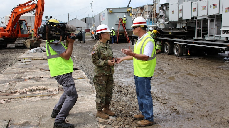 Tim Gouger (right) program manager, Rapid Response, Omaha District Technical Center of Expertise, speaks with Brig. Gen. Diana Holland, USACE South Atlantic Division Commander,at the Palo Seco power plant in Puerto Rico, Dec. 2017.  The rapid response team assisted with setting up two backup mega generators to provide temporary power in the aftermath of hurricane Maria in Sept. 2017.