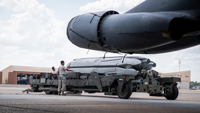 Load crew members of the 20th Aircraft Maintenance Unit prepare to load munitions on a B-52H Stratofortress during an Aircraft Monitor and Control test at Barksdale Air Force Base, La., Aug. 24, 2020. The test is performed every five to ten years to demonstrate the capability of the B-52 to provide the required voltage levels for the mission configuration in the AGM-86 air-launched cruise missile interface. (U.S. Air Force photo by Senior Airman Lillian Miller)