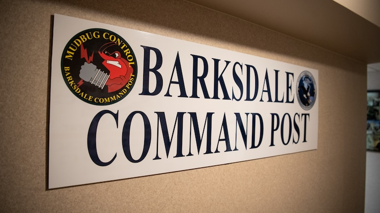 """A """"Barksdale Command Post"""" sign hangs at the entrance of the 2nd Bomb Wing command post at Barksdale Air Force Base, La., Sept. 9, 2020. Barksdale's command post is responsible for providing nuclear command and control for military forces. (U.S. Air Force photo by Airman 1st Class Jacob B. Wrightsman)"""