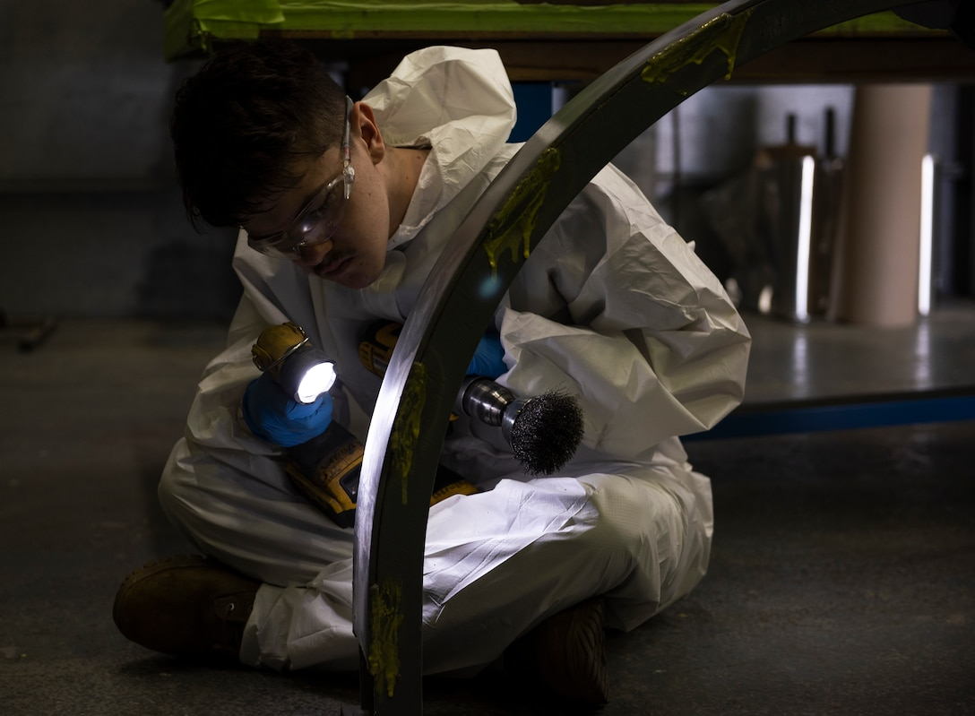 Senior Airman Tristan Casner, 48th Equipment Maintenance Squadron Fabrication Flight, inspects an aircraft component at Royal Air Force Lakenheath, England, Sept. 15, 2020. The Fabrication Flight maintains the structural integrity of aircraft using specialized tools and equipment to repair damage and fabricate replacement parts, ensuring the 48th Fighter Wing remains a ready and capable force. (U.S. Air Force photo by Airman 1st Class Jessi Monte)