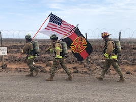 Firefighters assigned to the 726th Expeditionary Air Base Squadron participate in a ruck march at Chabelley Airfield, Djibouti, Sept. 11, 2020. The fire emergency service flight walked the perimeter of the base while carrying flags in remembrance of the 2,977 victims of the Sept. 11, 2001 attacks, with a special dedication to the 343 firefighters who tragically lost their lives that day. (Courtesy Photo)