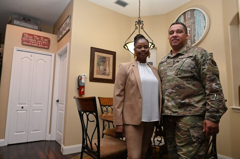 U.S. Air Force Tech. Sgt. JeanPaul Heath, a 125th Fighter Wing ground transportation vehicle operator, is pictured with his wife, Utophias, in their residential home for seniors and special needs citizens of Jacksonville, FL, Sept. 15, 2020. In October, the Heath's will open the home to up to six adults who will have round-the-clock care including residential habilitation, social activities, meals, transportation and laundry services, among other community living benefits. (U.S. Air National Guard photo by Tech. Sgt. Chelsea Smith)