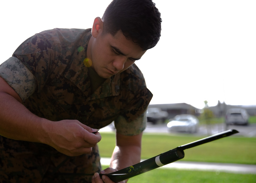 A U.S. Marine assembles his teams' improved very high frequency antennae they created at Camp Lejeune, N.C., Sept. 16.