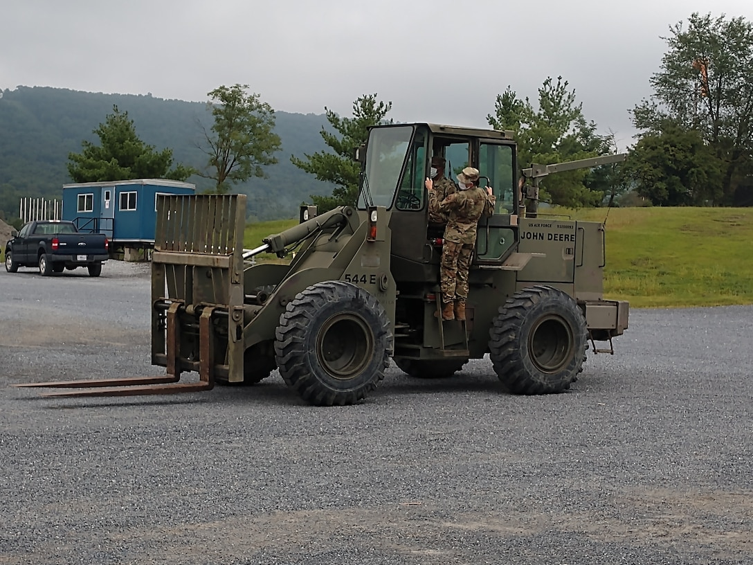 Airmen form the 174th Civil Engineering Squadron participate in a training exercise held at a training facility at Fort Indiantown Gap, Pennsylvania. (U.S. Air National Guard photo by MSgt. Christopher Collato)