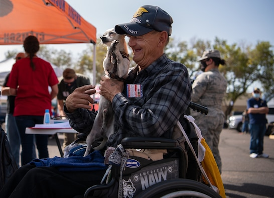 Donald, retired, waits for his dog, Riley, to receive care from the Street Dog Coalition volunteers at the 22nd Annual Homeless Veteran Stand Down in downtown Colorado Springs, Colorado, Sept. 15, 2020. The Street Dog Coalition volunteers performed a wellness check on Riley, which included giving him vaccines, testing him for heartworms and providing him with flea medication and a new stuffed toy. (U.S. Air Force photo by Airman 1st Class Amanda Lovelace)