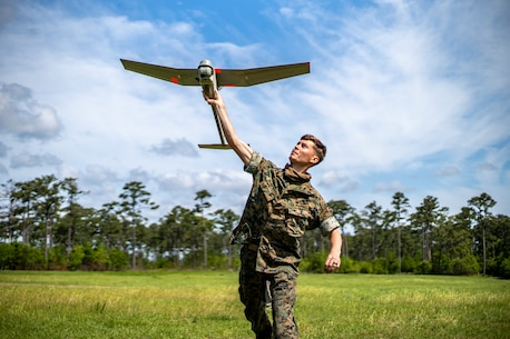 SPMAGTF-SC Marines train with an RQ-11B Raven during an operator course at Camp Lejeune, North Carolina. Marines with SPMAGTF-SC are training with unmanned aircraft systems to enhance their capabilities for upcoming missions.