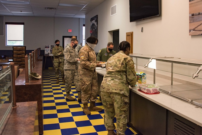 """Airmen line up at the DFAC for a home made lunch provided by command CMSgt Robbin Moore, August 27, 2020 at New Castle Air National Guard Base, Del. This was CMSgt Moore's first monthly """"Chat n Chew"""" event for 166th Airlift Wing NCOs. (USAF photo by Mr. Mitch Topal)"""