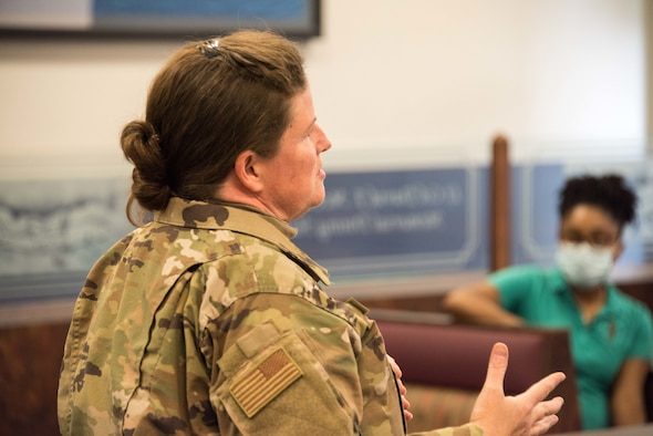"""MSgt Kathaleen Cassedy, 166th Airlift Wing Safety and Occupational Health Manager, talks about safety issues during CMSgt Moore's first monthly """"Chat n Chew"""" event, August 27, 2020 at New Castle Air National Guard Base, Del.  (USAF photo by Mr. Mitch Topal)"""