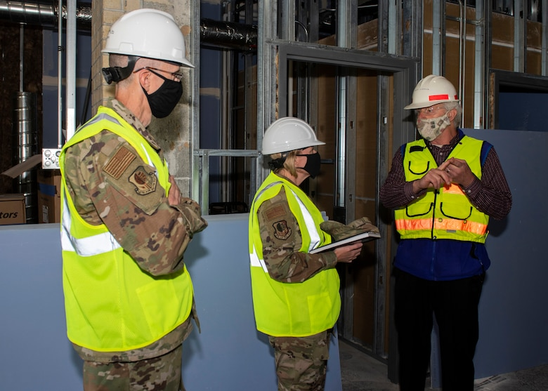 Jeffrey Liddle, 673d Medical Group hospital engineer, right, briefs U.S. Air Force Col. Kirsten Aguilar, Joint Base Elmendorf-Richardson and 673d Air Base Wing commander, and U.S. Air Force Chief Master Sgt. Lee Mills, JBER and 673d ABW command chief, on new construction and repairs to the Flight Medicine building during a 673d Aerospace Medicine Squadron immersion tour at Joint Base Elmendorf-Richardson, Alaska, Sept. 8, 2020. Aguilar familiarized herself with the 673d AMDS and its role in supporting readiness after  taking command of the installation July 14, 2020. The 673d AMDS maintains preventive medicine for the installation as well as flight readiness for the flying squadrons.