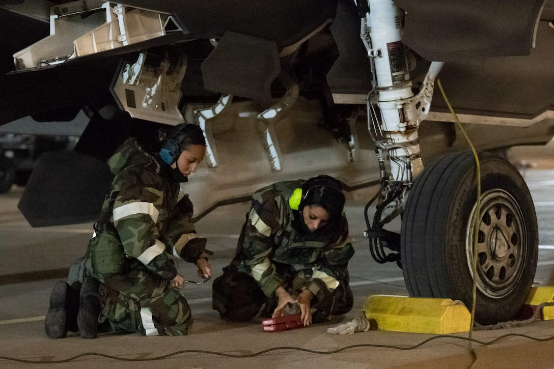 Senior Airman Deneen Clark and Staff Sgt. Aften Garcia, weapon loaders in the 419th Aircraft Maintenance Squadron, prepare an F-35A Lightning II to receive flares during an exercise