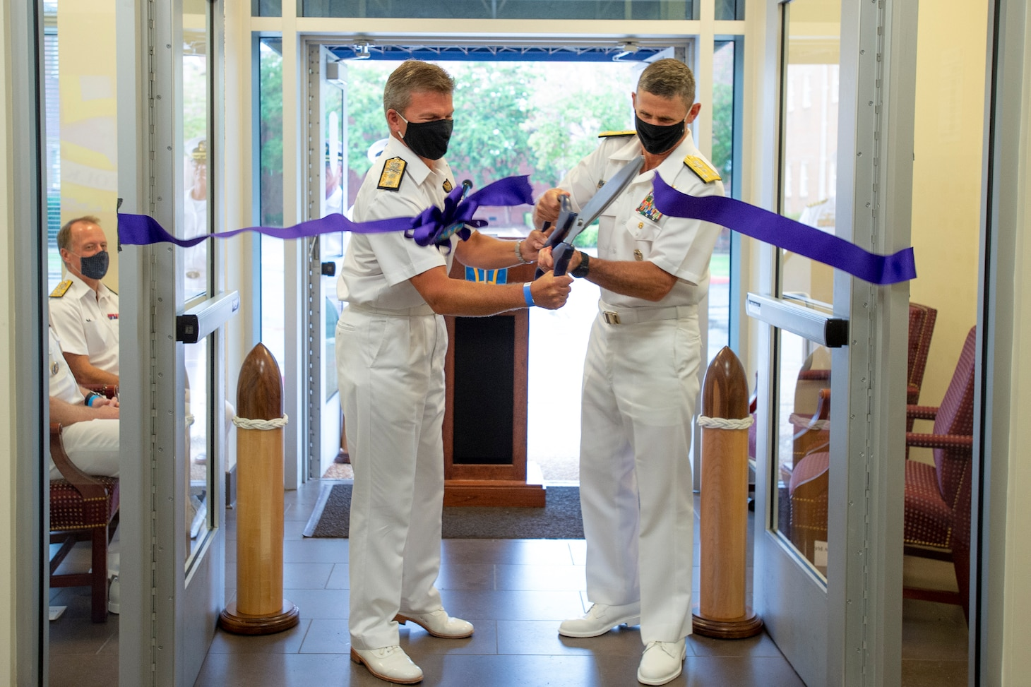 Vice Adm. Andrew Lewis, commander, Joint Force Command Norfolk (JFCNF) and U.S. 2nd Fleet, alongside Rear Adm. Andrew Betton, Deputy Commander, Joint Force Command Norfolk, cut the ribbon to commemorate JFCNF's achievement of initial operational capability (IOC), Sept. 17.