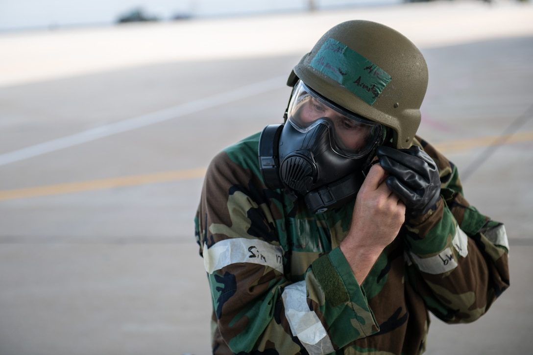 Airman 1st Class Alexander Armitage, avionics technician in the 419th Aircraft Maintenance Squadron, dons mission oriented protective posture gear during an exercise