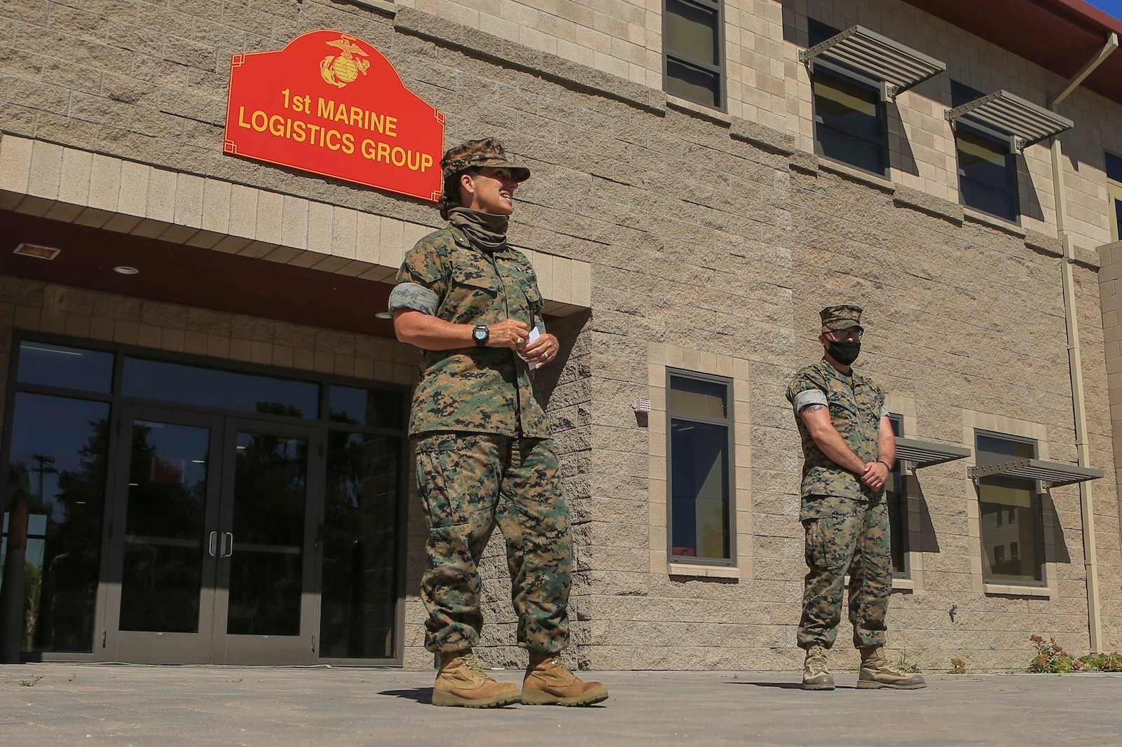 Commanding General of 1st Marine Logistics Group Brig. Gen. Bobbi Shea recognizes Cpl. Cameron Rider, a radio operator with Combat Logistics Regiment 1, winner of 1st MLG Innovation Award, for his design and fabrication of a vehicle-mounted antenna during an award presentation ceremony on Camp Pendleton, California, July 16, 2020.