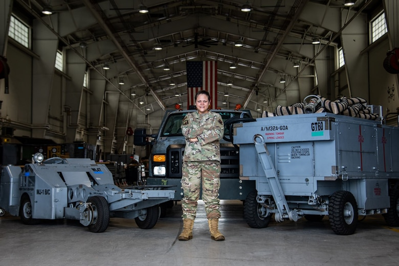 Tech. Sgt. Natalia Wood, 20th Equipment Maintenance Squadron aerospace ground equipment maintenance Airman, poses in her workplace while showcasing the 20th Fighter Wing assets she maintains at Shaw Air Force Base, S.C., Aug. 25, 2020. In her role on the women's initiative team, she helped champion the effort to ensure practical lactation spaces and breastmilk storage for women in the Department of the Air Force. (U.S. Air Force photo by Staff Sgt. Sean Sweeney)