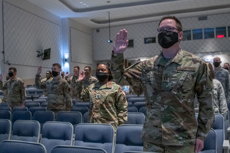 """Air Force and Space Force officers take a ceremonial oath of office during a virtual commissioning ceremony Sept. 15, 2020, on Maxwell Air Force Base, Alabama. Eighteen Maxwell-Gunter officers took the oath, led by U.S. Space Force Chief of Space Operations Gen. John W. """"Jay"""" Raymond. The general administered the oath to more than 300 officers and enlisted members stationed around the world following his virtual presentation at the Air Force Association's 2020 Virtual Air, Space and Cyber Conference. (U.S. Air Force photo by Trey Ward)"""