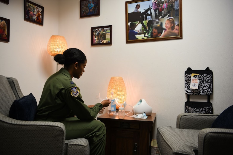 Capt. Ebony Godfrey, 20th Air Force nuclear command, control and communication operations chief, assembles a breast pump in the 20th Air Force headquarters lactation room, Sept. 3, 2020, at F. E. Warren Air Force Base, Wyo. Lactation rooms at bases across the Air Force provide a private and comfortable environment for nursing mothers to express breastmilk, which promotes health for both the mother and baby. Enabling mothers to fulfill their motherhood responsibilities at work benefits mission readiness, both in the short and long term. (U.S. Air Force photo by Capt. Ieva Bytautaite)