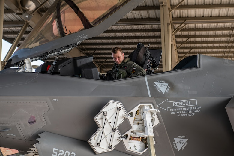 Capt. Dylan Meador, F-35 pilot in the 388th Fighter Wing, performs post-flight checks after leading two consecutive offensive counter-air sorties during an exercise