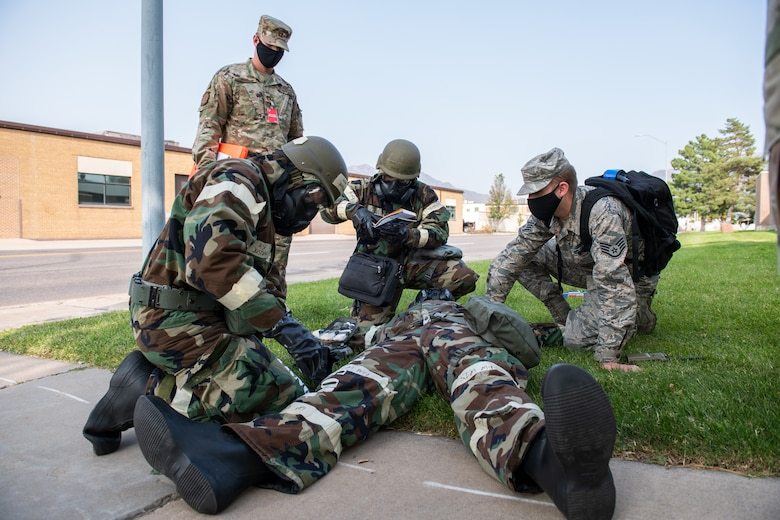 Airmen from the 388th Operations Support Squadron and the 419th Operations Support Squadron render self-aid buddy care to a fellow Airman during a training exercise