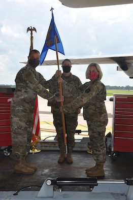 a commander hands the unit flag to the new commander