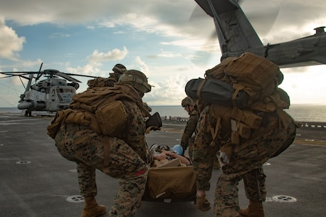 Marines and Sailors with the 31st Marine Expeditionary Unit transport simulated casualties during a mass casualty drill, or Nightingale, aboard amphibious assault ship USS America (LHA 6) in the Philippine Sea, Sept. 10, 2020.