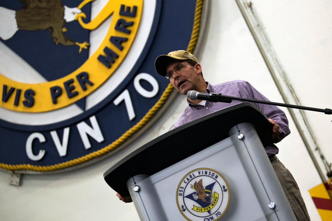 Defense Secretary Dr. Mark T. Esper speaks from behind a dias.