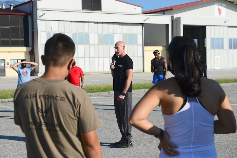 Chief Master Sgt. Jamie Newman, 31st Fighter Wing command chief, speaks at the Run for the Dream 5k at Aviano Air Base, Italy, Sept. 12, 2020. The event commemorated the anniversary of Dr. Martin Luther King's 'I have a dream' speech. (U.S. Air Force photo by Tech. Sgt. Tory Cusimano)