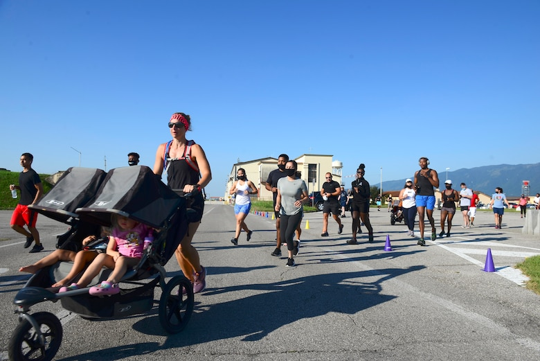 Runners depart the start line during the Run for the Dream 5k event at Aviano Air Base, Italy, Sept. 12, 2020. Signs featuring famous quotes from Dr. Martin Luther King Jr. lined the running route. (U.S. Air Force photo by Tech. Sgt. Tory Cusimano)