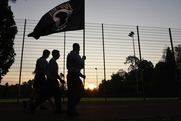 U.S. Air Force Airmen, assigned to the 86th Security Forces Squadron, carry the POW/MIA flag around the base track to commemorate National POW/MIA Recognition Day at Ramstein Air Base, Germany, Sept. 18, 2020.