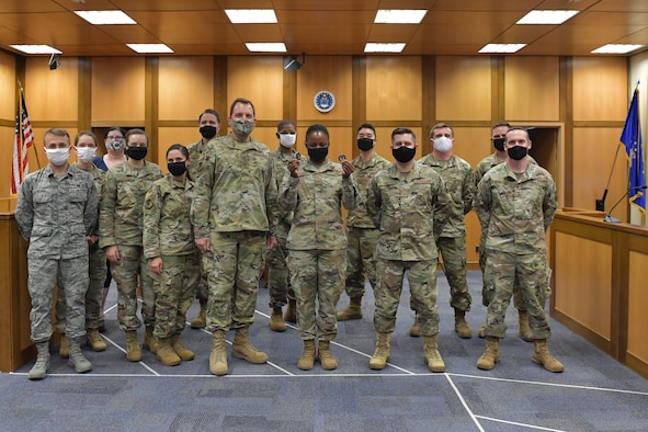 A group of Airmen standing in a courtroom.