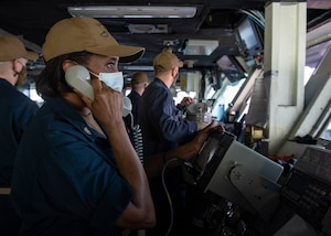 200918-N-DQ752-1020 STRAIT OF HORMUZ (Sept. 18, 2020) Chief Hospital Corpsman Debra Pee conducts communications from the bridge of the aircraft carrier USS Nimitz (CVN 68) during a Strait of Hormuz transit, Sept. 18. Nimitz Carrier Strike Group is deployed to the U.S. 5th Fleet area of operations in support of naval operations to ensure maritime stability and security in the Central Region, connecting the Mediterranean and the Pacific through the western Indian Ocean and three strategic choke points. With Nimitz as the flagship, deployed strike group assets include staffs, ships and aircraft of Carrier Strike Group 11, Destroyer Squadron 9, USS Princeton (CG 59) and Carrier Air Wing 17. (U.S. Navy photo by Mass Communication Specialist 3rd Class Cheyenne Geletka)