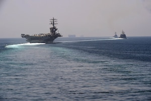 200918-N-IE405-1073 STRAIT OF HORMUZ (Sep. 18, 2020) The aircraft carrier USS Nimitz (CVN 68), guided-missile cruiser USS Princeton (CG 59) and guided-missile destroyer USS Sterett (DDG 104) steam in formation during a Strait of Hormuz transit, Sept. 18. The Nimitz Carrier Strike Group is deployed to the U.S. 5th Fleet area of operations in support of naval operations to ensure maritime stability and security in the Central Region, connecting the Mediterranean and the Pacific through the western Indian Ocean and three strategic chokepoints. (U.S. Navy photo by Mass Communication Specialist 2nd Class Indra Beaufort)
