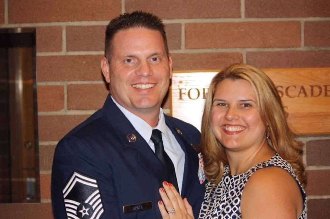 "U.S. Air Force Senior Master Sgt. Carl Joseph ""CJ"" Spatz III, air traffic controller and facility manager, poses for a photo with his wife, Angela Spatz, during his retirement day at Joint Base Lewis-McChord, Wash., Sept. 11, 2015. (Courtesy photo)"