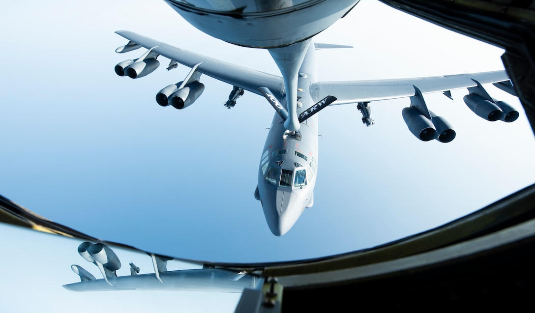 A U.S. Air Force B-52H Stratofortress, assigned to the 5th Bomb Wing at Minot Air Force Base, North Dakota, flies below a KC-135 Stratotanker from the 100th Air Refueling Wing, RAF Mildenhall, England, after receiving fuel above the Mediterranean Sea in support of a Bomber Task Force Europe mission, Sept. 16, 2020. The B-52s are deployed to RAF Fairford, England, in support of joint and combined training with U.S allies and partners. (U.S. Air Force photo by Senior Airman Jennifer Zima)