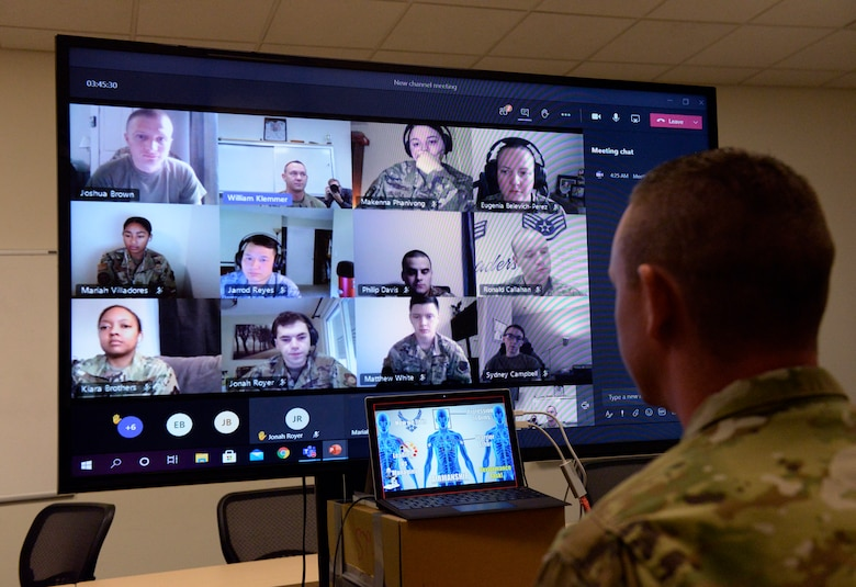 Tech. Sgt. William Klemmer, Airman Leadership School instructor, teaches via distance learning protocol under Health Protection Condition Charlie at Wright-Patterson Air Force Base Sept. 16. Klemmer instructs half of a class of 22 students. (U.S. Air Force photo/Ty Greenlees)