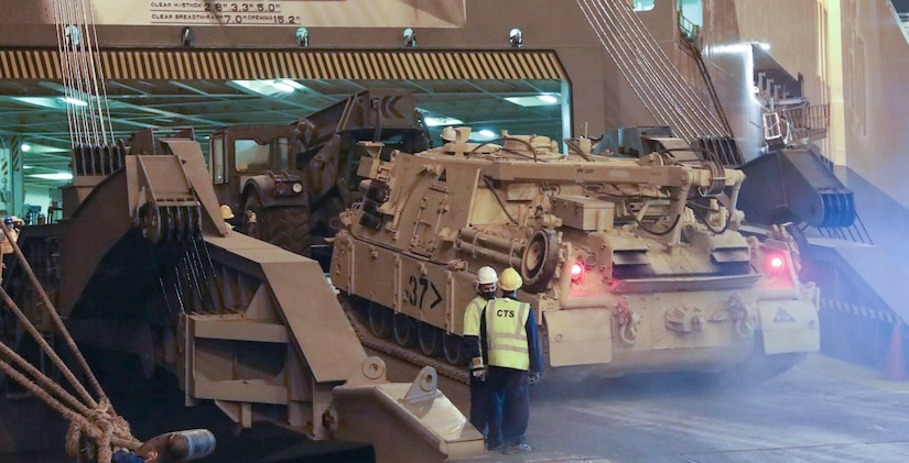 A Soldier from the 1184th Deployment and Distribution Support Battalion, from Mobile, AL drives a tank up the ramp and onto the ship at the Port of Shuiaba, Kuwait, September 11, 2020. The 1184th Deployment and Distribution Support Battalion, from Mobile, AL is responsible for the movement of nearly 400 pieces from several different units on this shipment. (U.S. Army Reserve Photo By Sgt. Vontrae Hampton)
