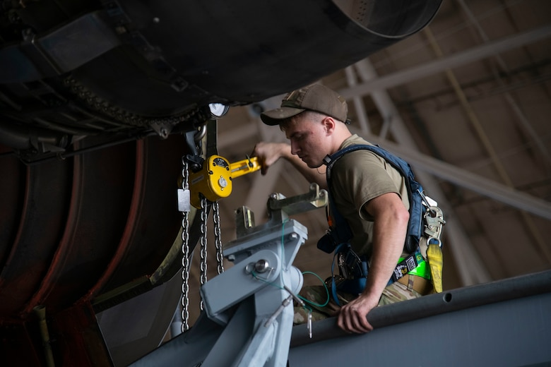 Airman 1st Class Tyler Jackson, 436th Aircraft Maintenance Squadron aerospace propulsion journeyman, raises a pylon during a C-5M Super Galaxy engine change September 9, 2020, at Dover Air Force Base, Delaware. Weighing between five to six tons and costing 15.5 million dollars, C-5M engines are handled with precision and care. (U.S. Air Force photo by Airman 1st Class Jonathan Harding).