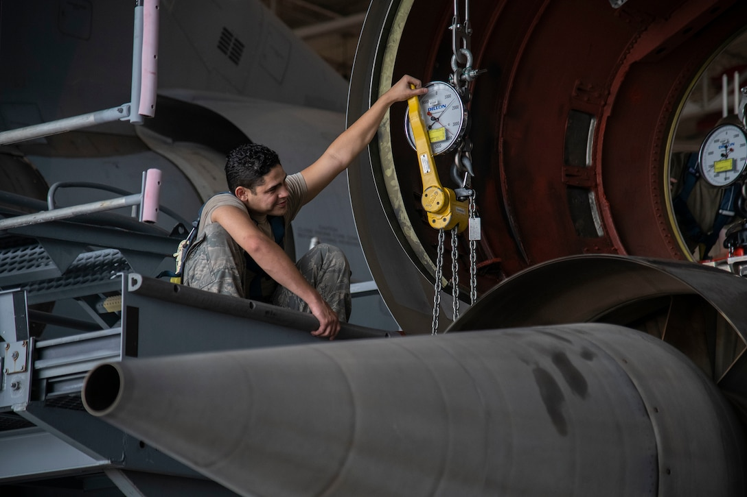 Airman 1st Class Gabriel Gonzalez, 60th Aircraft Maintenance Squadron aerospace propulsion journeyman, checks gauges to verify weight load during a C-5M Super Galaxy engine change September 9, 2020, at Dover Air Force Base, Delaware. Weighing between five to six tons and costing 15.5 million dollars, C-5M engines are handled with precision and care. (U.S. Air Force photo by Airman 1st Class Jonathan Harding)