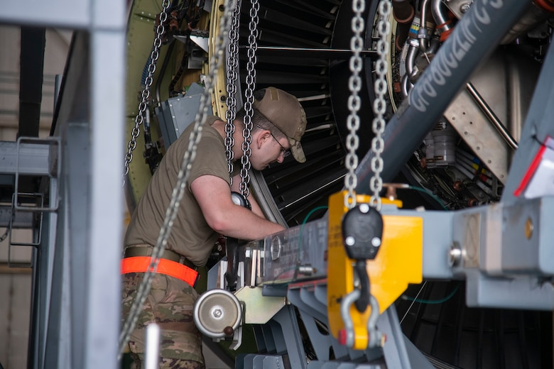 Senior Airman Kody Belt, 436th Aircraft Maintenance Squadron aerospace propulsion journeyman, secures the engine to a cradle C-5M Super Galaxy engine change September 9, 2020, at Dover Air Force Base, Delaware. This is the first C-5M engine change conducted by Airmen in six years. (U.S. Air Force photo by Airman 1st Class Jonathan Harding)
