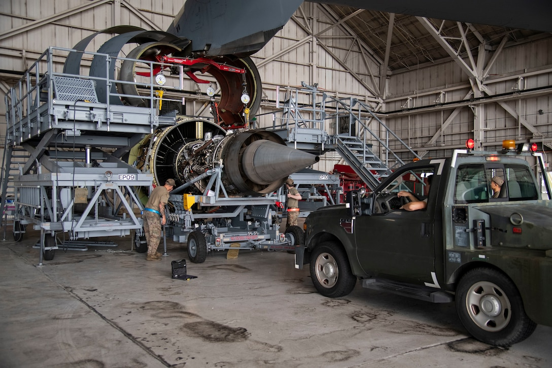 Maintainers prepare to move the recently lowered engine from under the C-5M Super Galaxy C-5M engine change September 9, 2020, at Dover Air Force Base, Delaware. This is the first C-5M engine change conducted by Airmen in six years. (U.S. Air Force photo by Airman 1st Class Jonathan Harding)